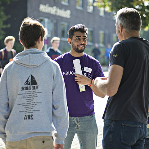 Student helping during an open day