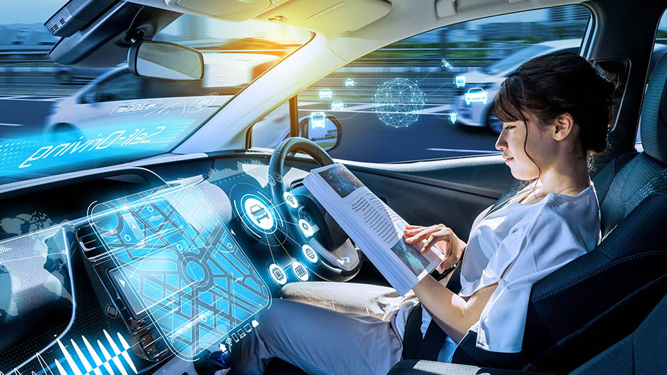 Woman reading in a self-driving car.
