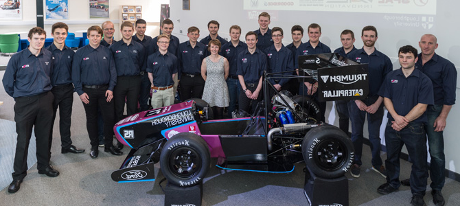Students standing around a Formula Student racing car